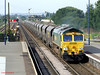Freightliner 66550 passes through Barnetby with a long rake of empty coal wagons on 20th August 2009.