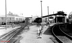 "Looking east at Bad Doberan; the track on the right is a standard-gauge bay, whereby the small engine shed (right) is accessed; the centre of the yard is the 900mm gauge ""Molli"". 10th April 1991."