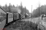 99 1771 leads the 11.57 Cranzahl to Kurort Oberwiesenthal into Niederschlag; a passing loop is here, and 99 1788 waits with a Cranzahl train. 13th April 1991.